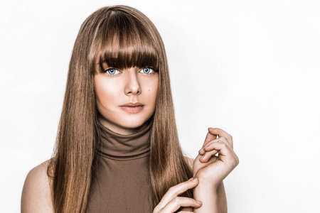 Photo pour Beauty portrait of young natural model with perfect long healthy shiny hairstyle isolated on white posing in studio. Pretty girl with stylish smooth haircut. Hairstyle concept.Teenager hair model - image libre de droit