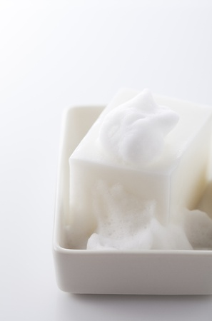 white soap bar with bubbles