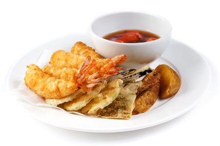 Photo pour shrimps in batter and a cup with soy sauce and ginger in a white plate on an isolated white background - image libre de droit