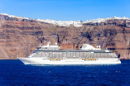 Cruise ship liner near the Santorini island. Santorini classically Thera or Thira is an island in the southern Aegean Sea, Cyclades in Greece.