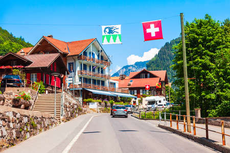 Photo pour Traditional local houses in Lauterbrunnen village in the Interlaken district in the Bern canton of Switzerland - image libre de droit