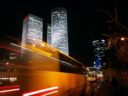 blurred bus in Tel Aviv at night