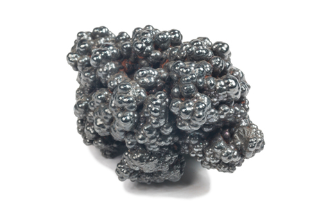detailed macro photo of Hematite mineral (sacred mineral) isolated over white