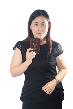 Beautiful young woman holding a passport isolated on white background