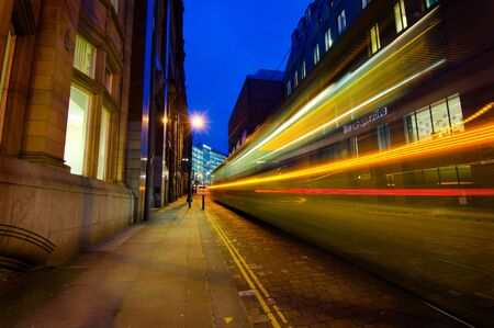 A tail lights of a tram passing through Manchester city centre