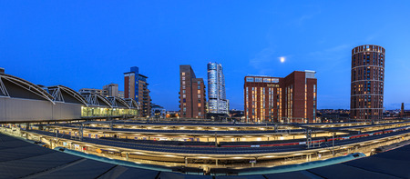 Leeds city skyline of modern architecture and rail tracks in the foreground, Leeds, England