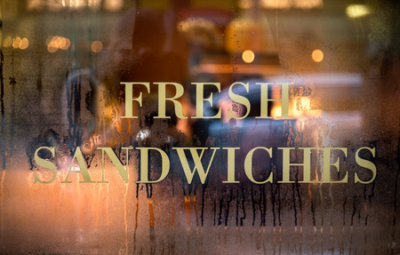 Sign of Fresh Sandwich displayed on cafe window.