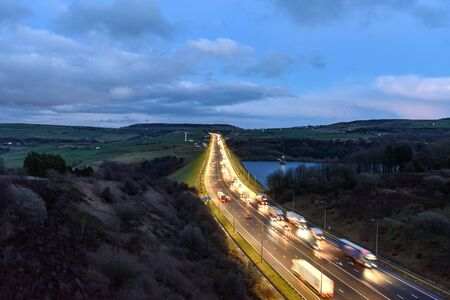 Photo for Busy traffic on M62 motorway near Leeds, West Yorkshire, England. - Royalty Free Image