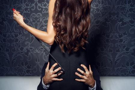 Rich businessman grip woman ass at night, bdsm