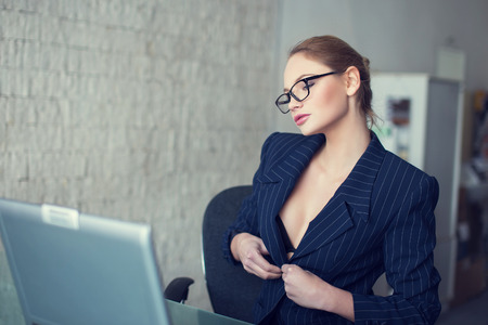Photo for Sexy secretary in glasses undress in office, online flirt and desire - Royalty Free Image