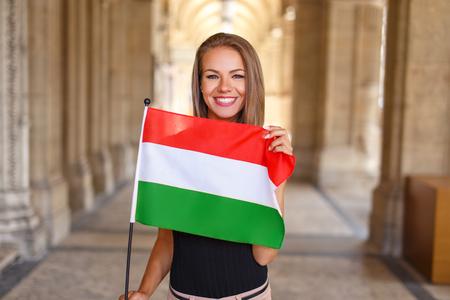 Photo pour Happy young woman smile with hungarian flag - image libre de droit
