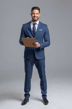 Photo pour Happy young confident Caucasian manager with clipboard on gray background - image libre de droit