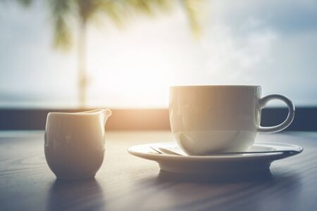 Photo pour Hot coffee with milk on table  in the morning time - image libre de droit