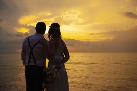 Foto für happy romantic wedding couple in love and look at the horizon with sunset - Lizenzfreies Bild