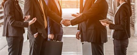 Foto de business people  handshake concept. shaking hand of group of businessman negotiation closing a deal city background - Imagen libre de derechos
