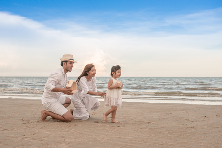 Photo pour parent's hands and daughter holding private property in sea beach - image libre de droit