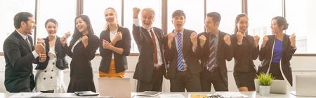 Foto de Business People Celebrating In Board Room successful concept. - Imagen libre de derechos