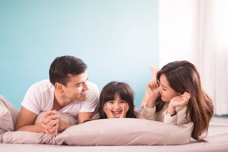 Photo for happy asian family spending time together in bedroom. family and home concept - Royalty Free Image