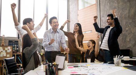 Foto de Group of Asian team creative business people Happy to be successful partnership teamwork concept - Imagen libre de derechos
