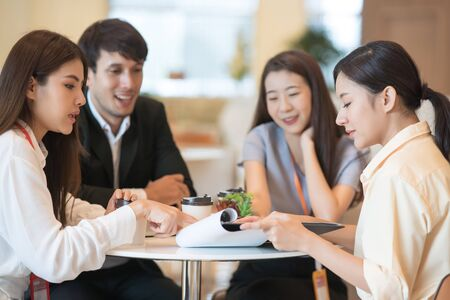 Photo pour Young Asian woman and business people are meeting in office discussion with colleagues . Group of Business team working and share ideas about project to partners - image libre de droit