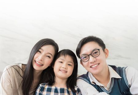 Photo pour Portrait of happy Asian family spending time together on sofa in living room. family and home concept. - image libre de droit
