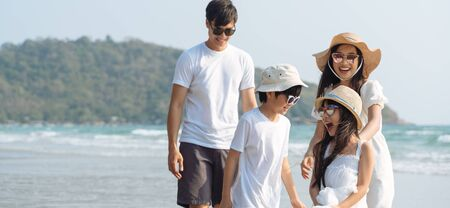 Photo for Asian Family walking at beach with kids happy vacation concept - Royalty Free Image