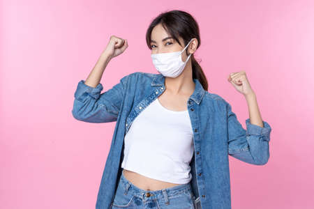 Photo pour Young happy Asian woman wearing hygienic mask - image libre de droit