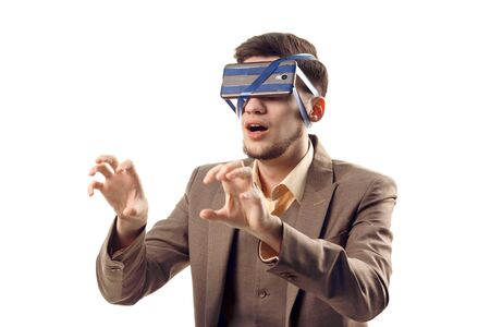 Photo for A humorous photo of modern technologies. Young guy with a phone attached to the head using a tape. Virtual reality gadget. Cut out on white - Royalty Free Image