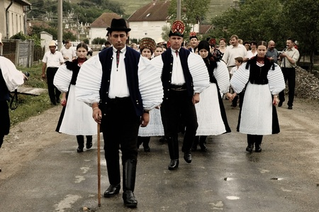 SIC, ROMANIA - CIRCA JUNE, 2004: Celebration of a traditional Hungarian wedding in traditional clothes at the Sic Village Festival Days, at June, 2004, in Sic (Szek), Romania