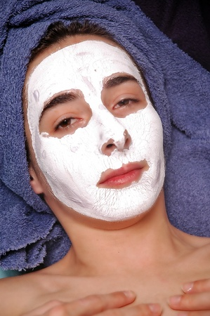 Fresh woman with facial mask