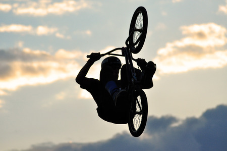 BONTIDA - JUNE 19  Unidentified BMX rider making a bike jump during the BMX Competition, at Electric Castle Festival on June 19, 2014 in the Banffy castle in Bontida, Romania