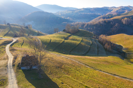 Autumn aerial shot of a ranch, homestead in Apuseni mountains. Drone view of rural place in Transylvania, Romania
