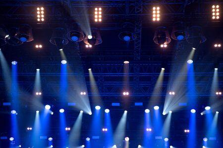 Photo pour Blue stage lights at music festival - image libre de droit