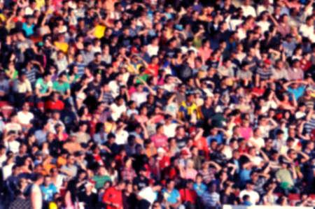 Photo pour Blurred crowd of spectators in a stadium - image libre de droit