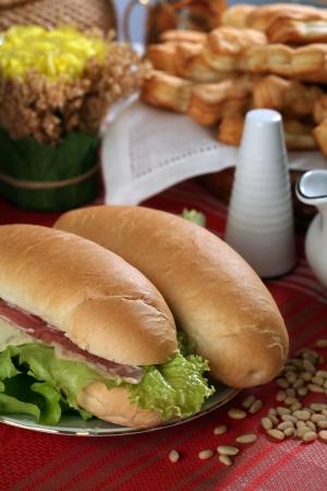 beautiful large sandwich on a table among bakery