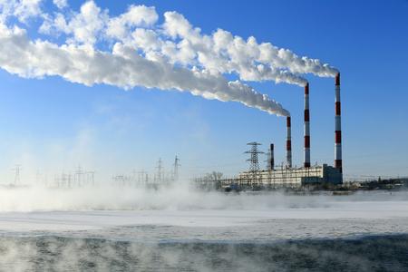 winter landscape smoke from the chimneys Zainsk TPP against the blue sky frosty misty morning