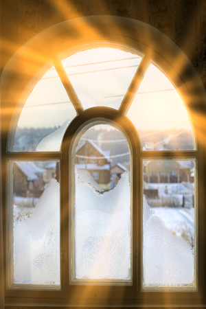 closeup texture background window in hoarfrost in sunlight raysの写真素材