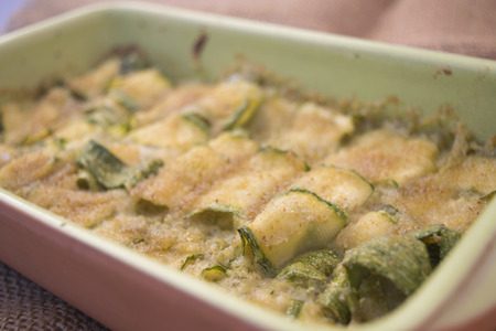 oven pan of zucchini au gratin with breadcrumbs