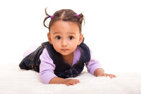Beautiful mixed race baby lying on the floor
