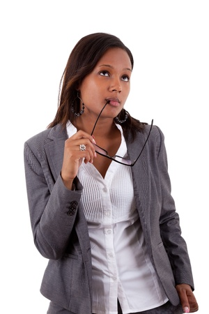 Thoughtful african american businness woman holding glasses , isolated on white background