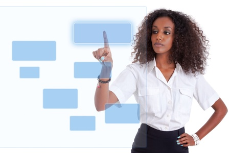 Young african american business woman pushing or pointing a transparent screen isolated on white background