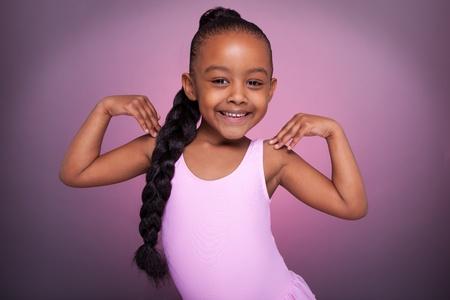 Portrait of a cute little African American girl dancing