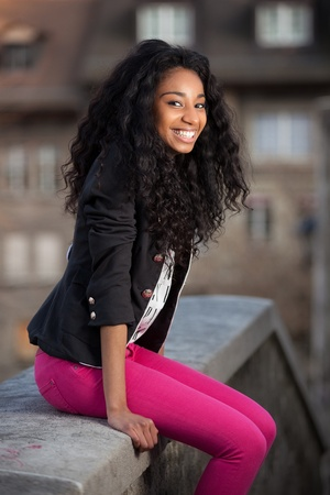 Outdoor of a  portrait happy young african american teenage girl