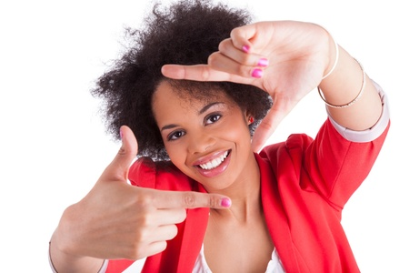 Beautiful african american woman making frame with her hands, isolated on white background