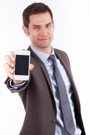 Young cuacasian businessman  showing something on a smartphone, isolated on white background
