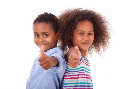 Photo for African American boy and girl making thumbs up gesture, isolated on white background - Black people - Royalty Free Image
