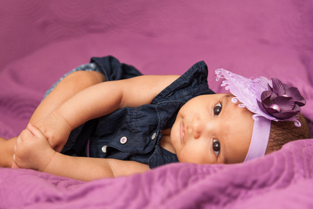 Photo for Adorable little african american baby girl looking - Black people - Royalty Free Image