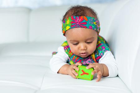 Photo pour Portrait of little African American little girl playing - Black people - image libre de droit