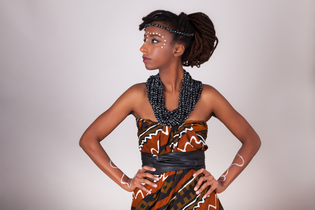 Young beautiful african woman wearing  traditional clothes and jewelry