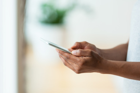 Photo for African american person holding a tactile mobile smartphone - Black people - Royalty Free Image